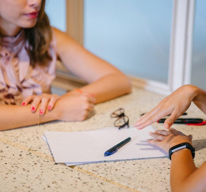 woman tutoring girl
